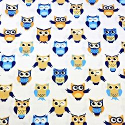 Tkanina w sówki niebiesko beżowe na białym tle