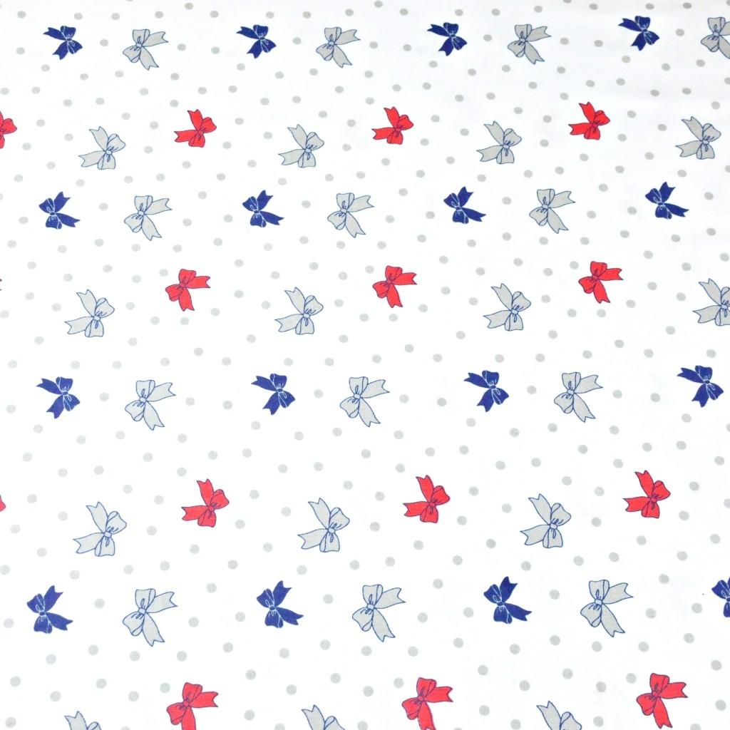 Tkanina w kokardki z kropeczkami na białym tle