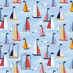 Tkanina w żaglówki kolorowe na niebieskim tle