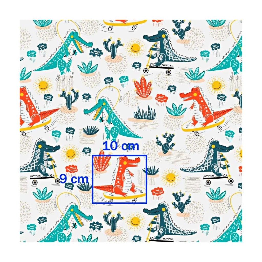 Tkanina w krokodyle zielono pomarańczowe na deskorolkach na białym tle