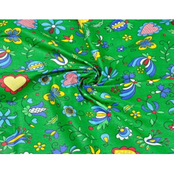 Tkanina wzór kaszubski niebieski na zielonym tle
