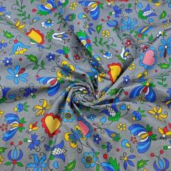 Tkanina wzór kaszubski niebieski na szarym tle