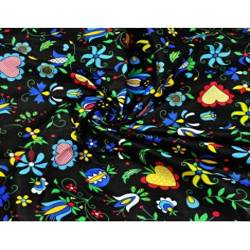 Tkanina wzór kaszubski niebieski na czarnym tle