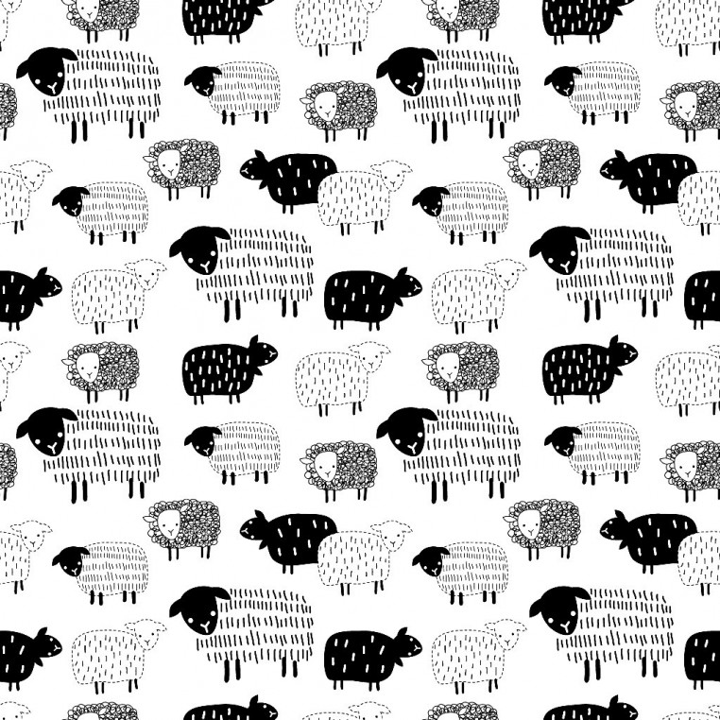 Tkanina w owieczki rysowane czarne na białym tle