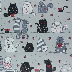 Tkanina w kotki szalone w pasach z czerwonym na szarym tle