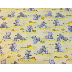 Tkanina króliki ze słoneczkami na żółtym tle