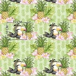 Tkanina w tukany z ananasami na zielonym tle
