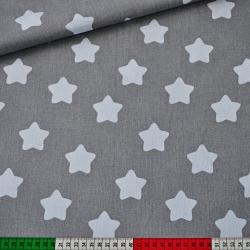 Tkanina w gwiazdki piernikowe białe na szarym tle