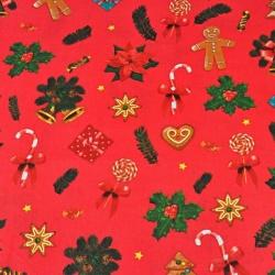 Tkanina wzór świąteczny z ciasteczkami na czerwonym tle