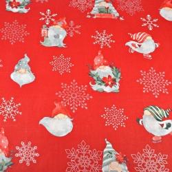 Tkanina wzór świąteczny skrzaty ze posrebrzonymi śnieżynkami na czerwonym tle