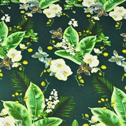 Imagén: kwiaty orchidea na ciemno zielonym tle